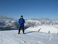 On the summit of Glas Bheinn Mhor, peaks of Glen Etive and Glencoe behind