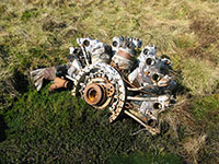 One of the engines from the B-26 Invader lying partially submerged in boggy ground