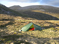 Campsite next to Loch nan Stuirteag on the Mòine Mhòr plateau, Cairn Toul in the background